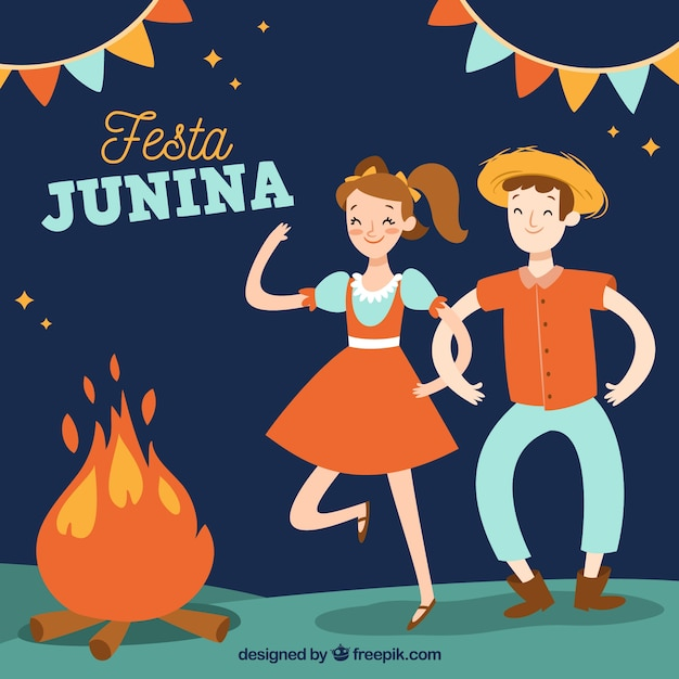 Festa junina background with people dancing\ around a campfire