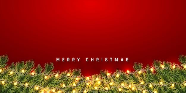 Праздничный фон рождество или новый год. рождественские еловые ветки с легкой гирляндой. фон праздника. Premium векторы