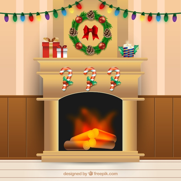 Fireplace background with christmas decoration Free Vector