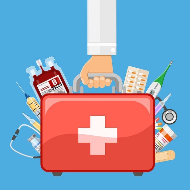 First aid kit in doctor hand Vector   Premium Download