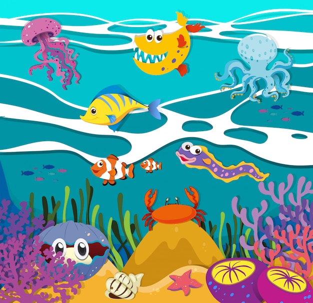 Fish and sea animals under the ocean Free Vector