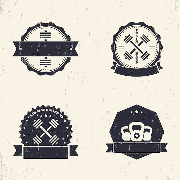 Fitness, gym grunge logos, badges, signs with crossed barbells, illustration Premium Vector