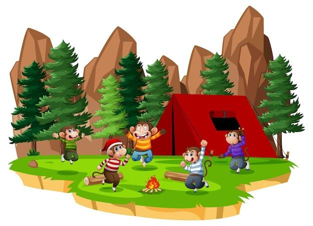 白い背景の公園のシーンでジャンプする5匹の小猿 無料ベクター