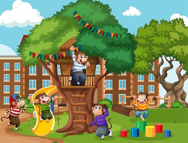 Cinque scimmiette che saltano nella scena del parco giochi Vettore gratuito