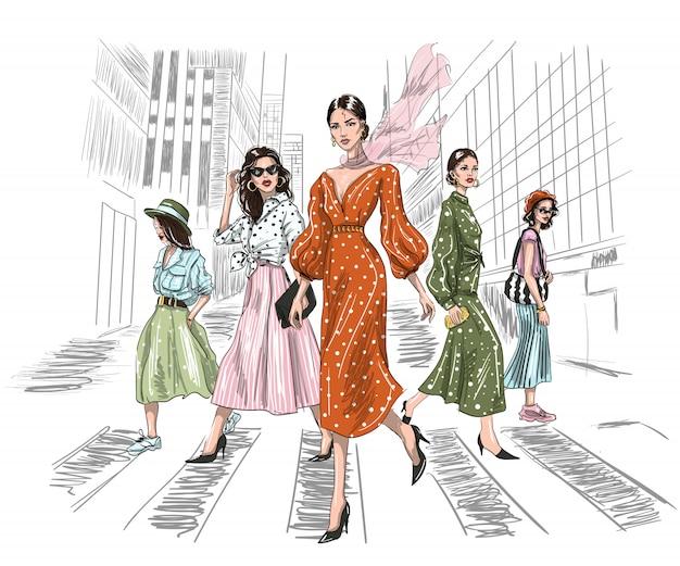 Five women walking on a crosswalk in big city Premium Vector