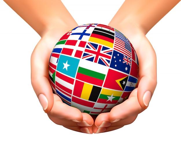 グローブと手で世界の国旗。 Premiumベクター