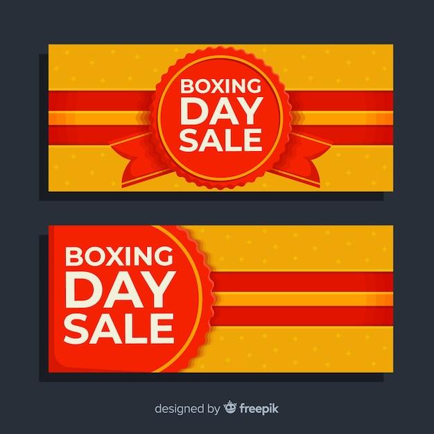 ラベルとリボンとフラットボクシングの日セールバナー 無料ベクター
