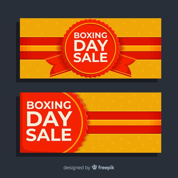Flat boxing day sale banners with label and ribbons Free Vector