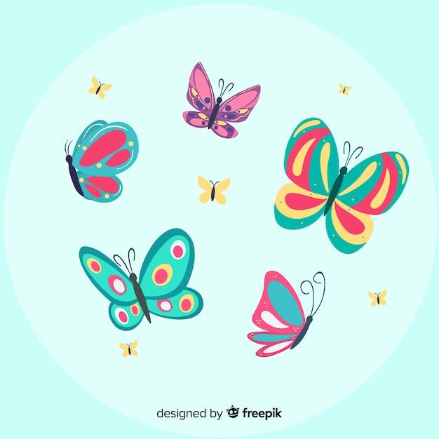 フラット蝶の背景を飛んで Premiumベクター