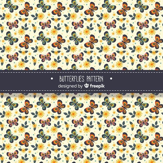 Flat butterflies pattern Free Vector