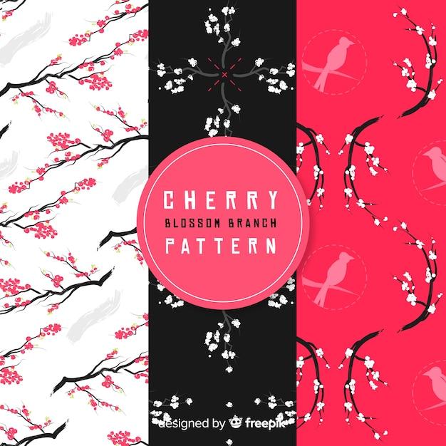 Flat cherry blossom pattern Free Vector