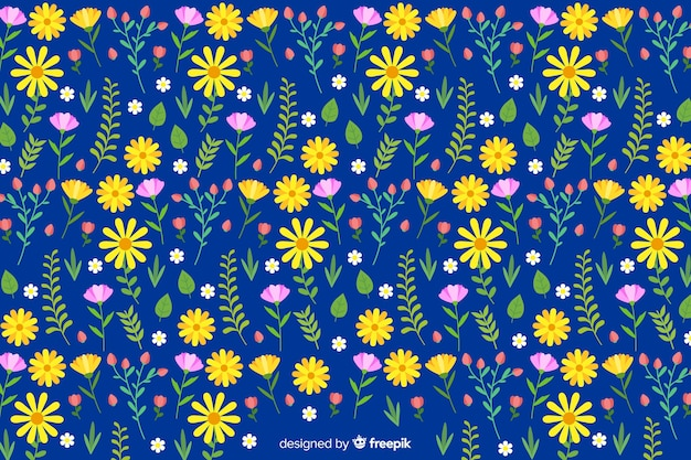 Flat colorful flowers and leaves background Free Vector