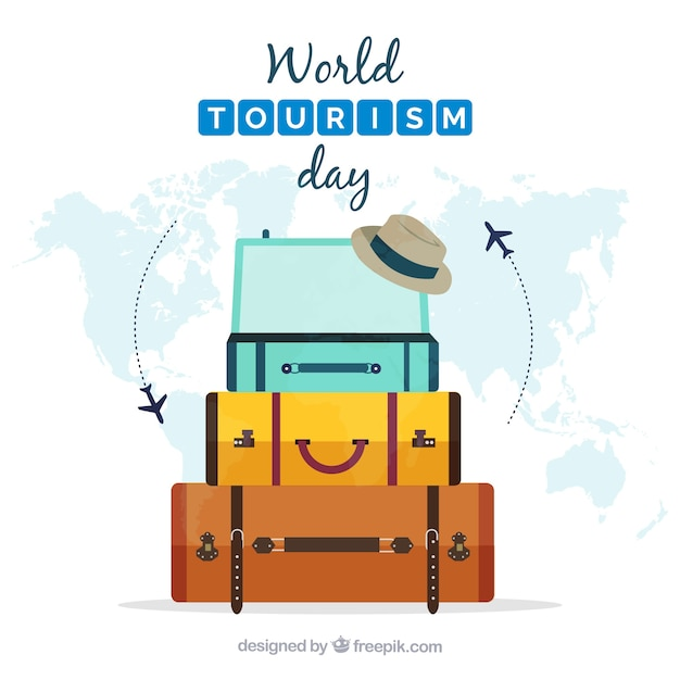 Flat composition with luggage and world map Free Vector