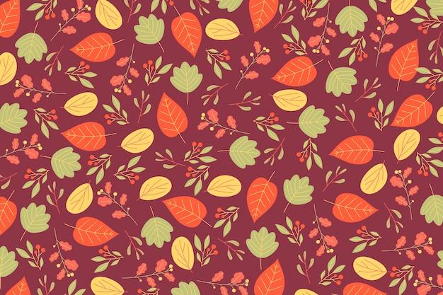 フラットなデザインの秋の葉の背景 無料ベクター