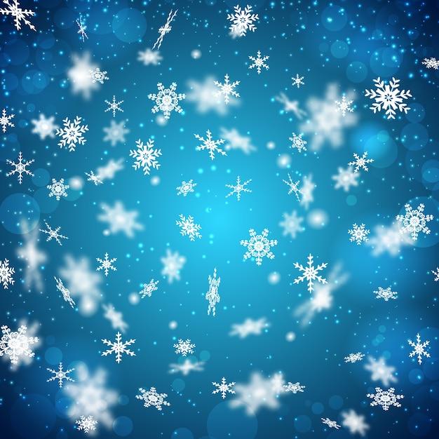 Плоский дизайн синий фон с падающими белыми снежинками разной формы Бесплатные векторы