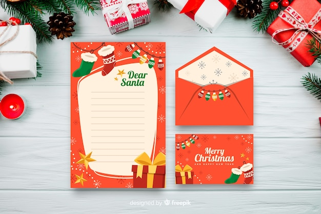 Flat design of christmas stationery template Free Vector