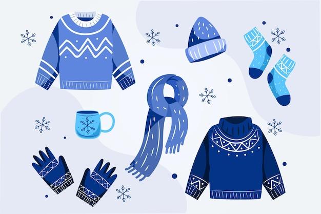 Плоский дизайн уютной зимней одежды Premium векторы