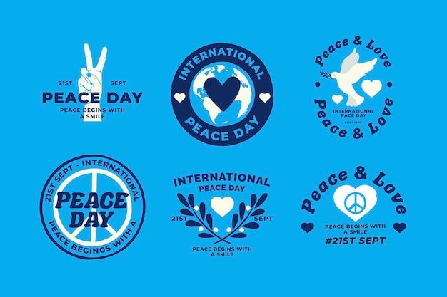 Flat design international day of peacebadges Premium Vector