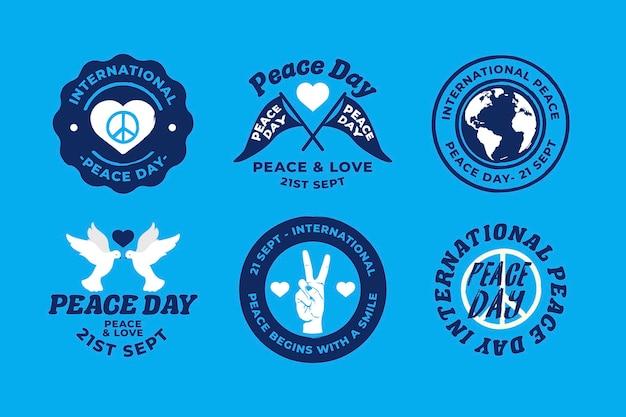 Flat design international day of peacebadges Free Vector