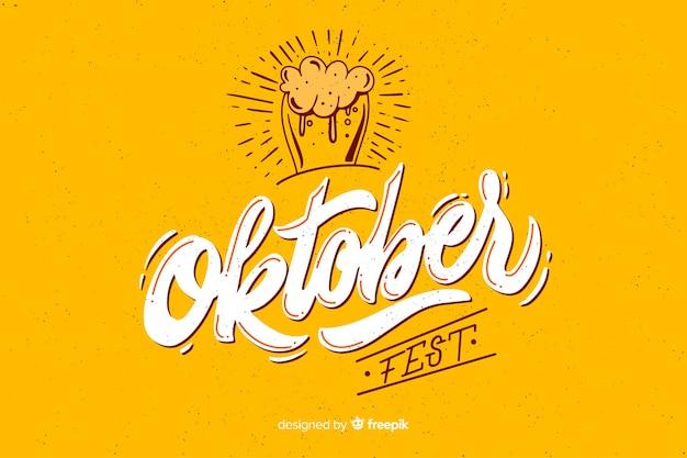 Flat design oktoberbest with glass of beer Free Vector