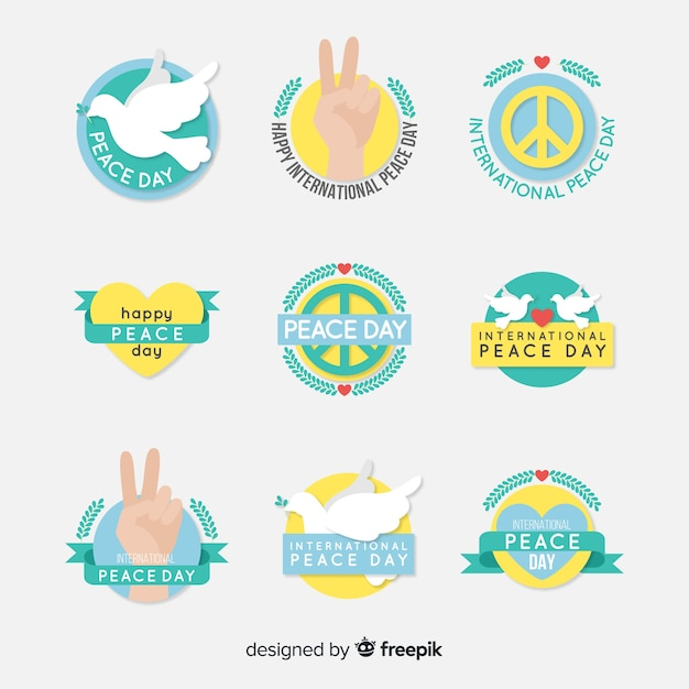 Flat design peace day label collection Free Vector