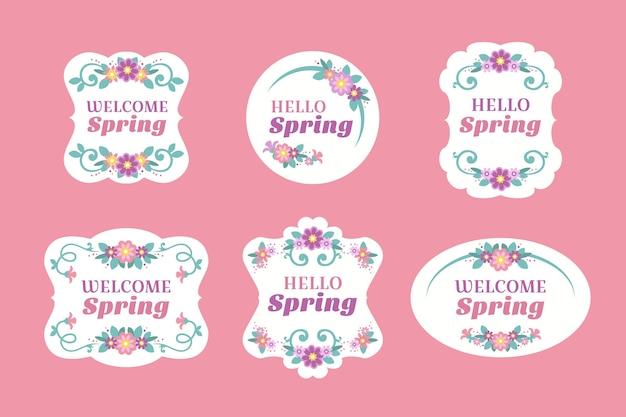 Flat design spring label with floral frames Free Vector