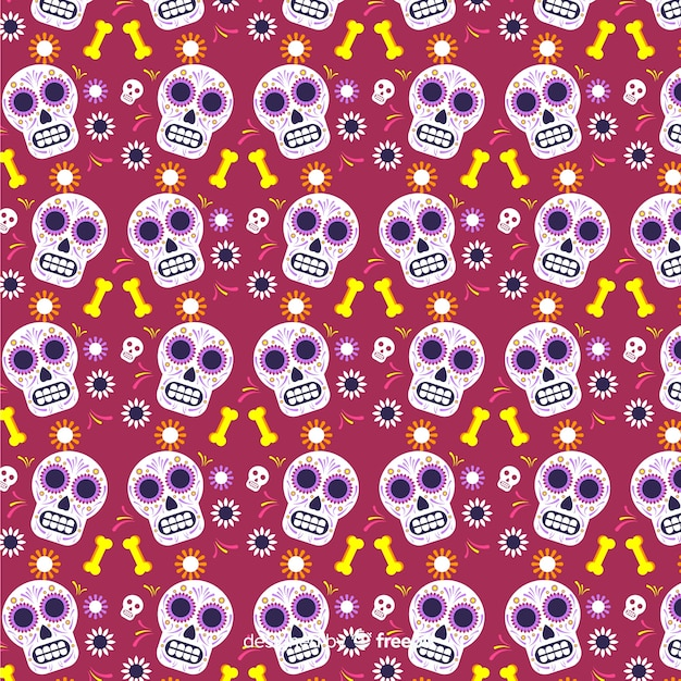 Flat día de muertos red with skulls pattern Free Vector