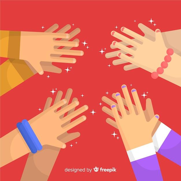 Flat hands applauding background Free Vector