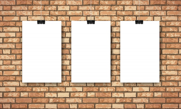 Flat interior with three empty white posters on brown brick wall. trendy loft room scenery background, fashion gallery exhibition interior. Premium Vector
