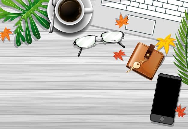 녹색 잎 사무실 요소와 사무실 작업 테이블의 평면 배치 무료 벡터