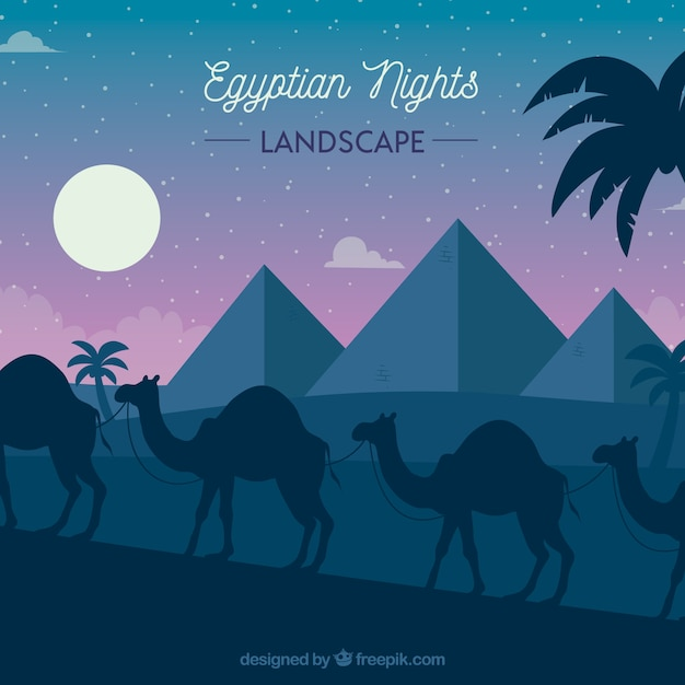 Flat night landscape with egyptian pyramids and caravan of camels Free Vector