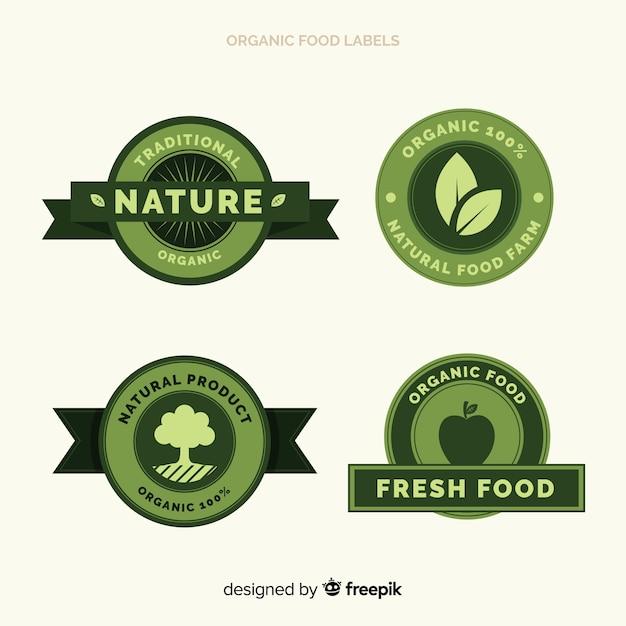 Flat organic fruit label set Free Vector