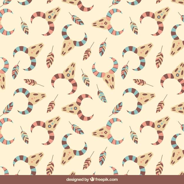 Flat pattern of animal skulls in boho style Free Vector