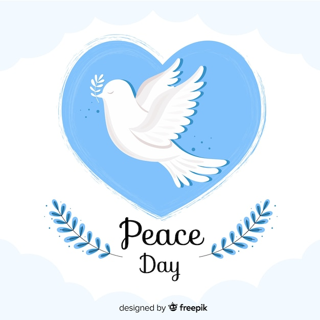 Flat peace day in a heart bubble Free Vector