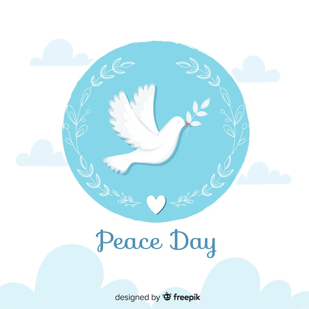 Flat peace day with dove and olive leaves Free Vector