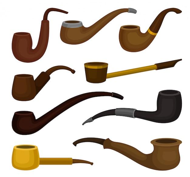 Плоский набор различных видов табачных трубок. старинные деревянные трубки для курения. классический аксессуар для курящих Premium векторы