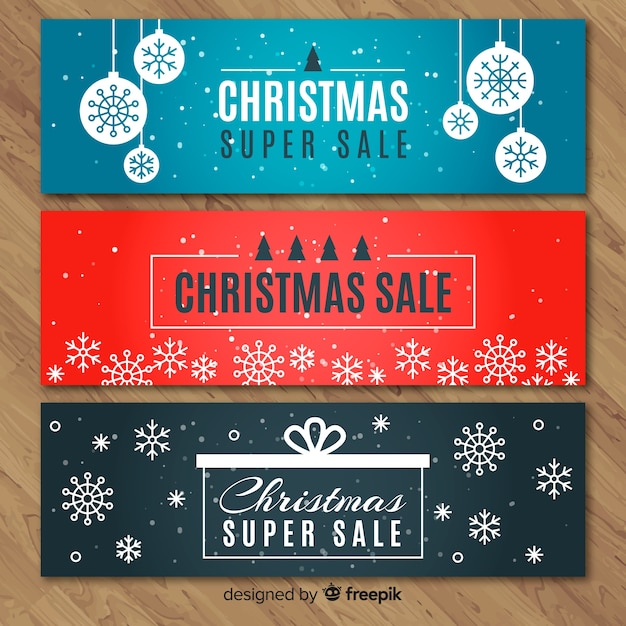 Flat snowflakes christmas sale banner Free Vector