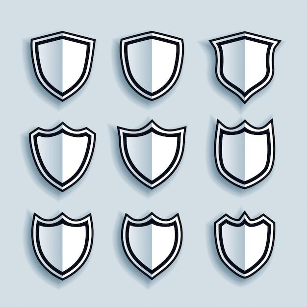 フラットスタイルのシールドシンボルまたはバッジセット 無料ベクター