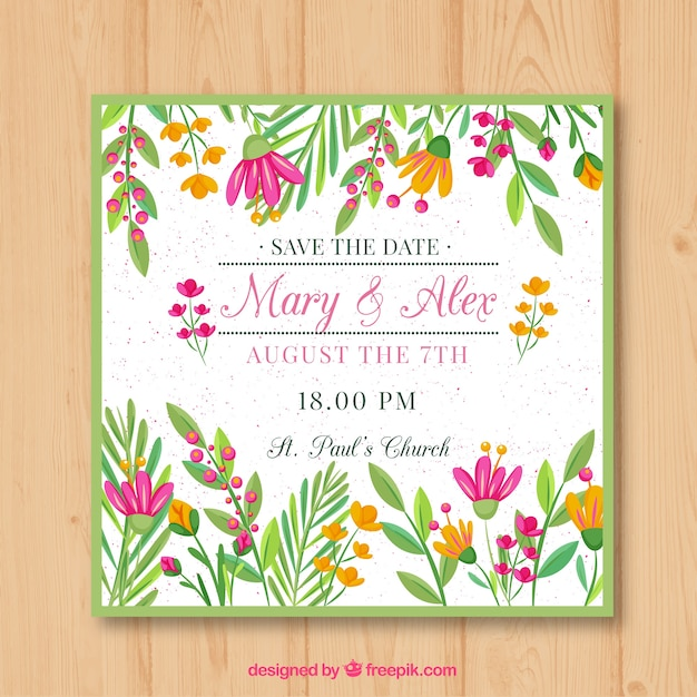 Flat wedding invitation with a floral frame Free Vector
