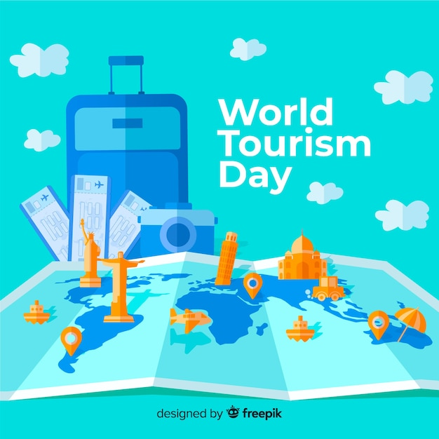 Flat world tourism day with luggage and map Free Vector