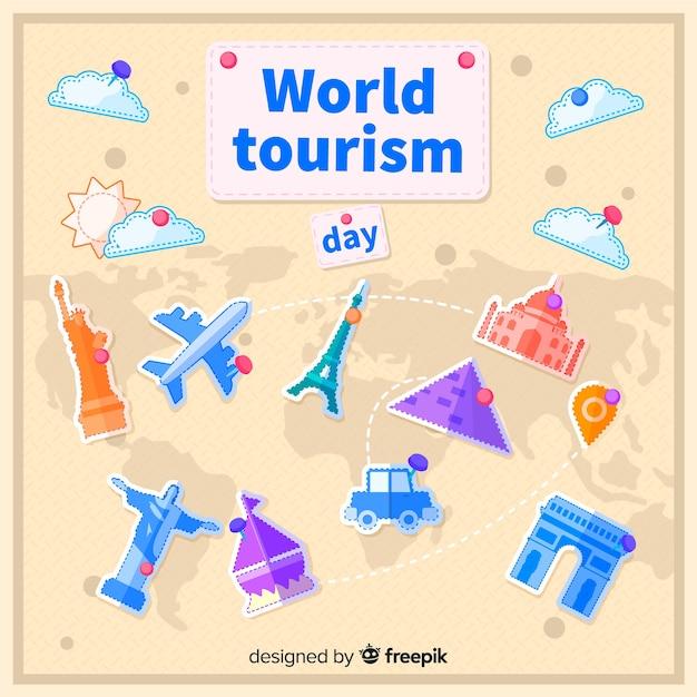 Плоский всемирный день туризма с туристической достопримечательностью Бесплатные векторы