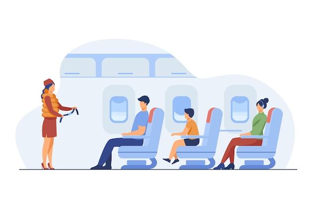 安全上の注意を説明する客室乗務員。乗客、飛行機、ベルトフラットベクトルイラスト。旅行と休暇のコンセプト 無料ベクター