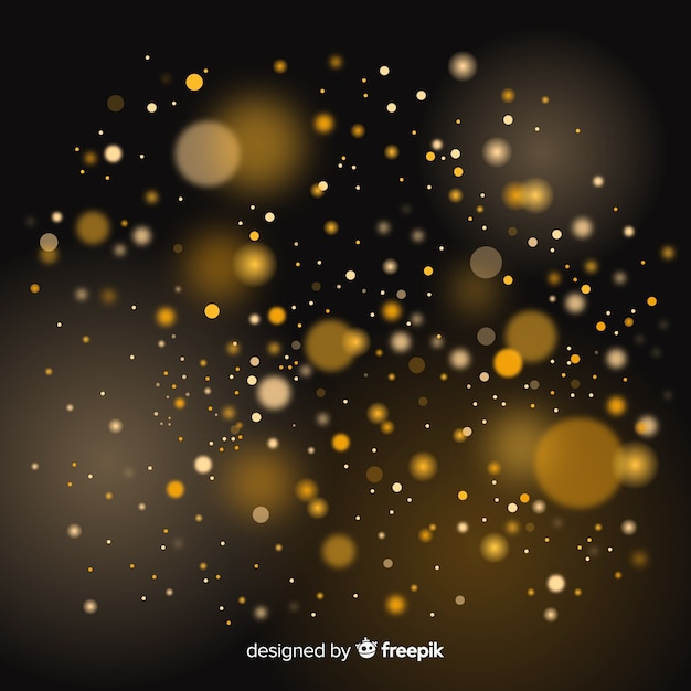 Floating golden particles bokeh effect Free Vector