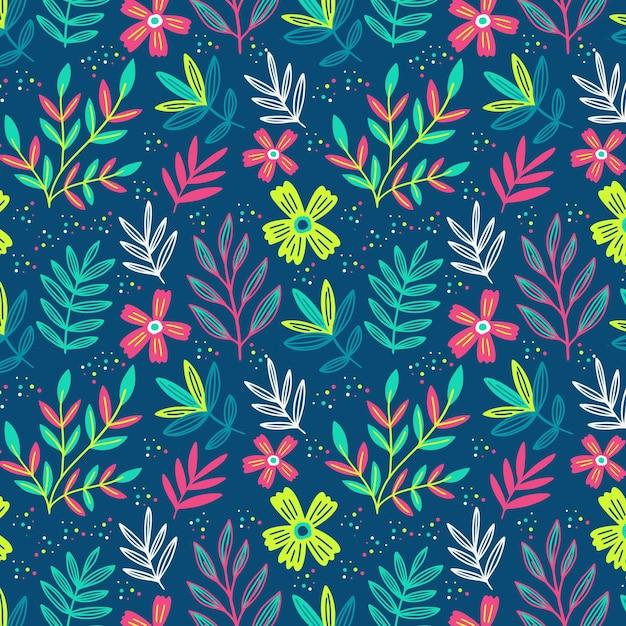 Цветочный узор с разноцветными листьями Бесплатные векторы