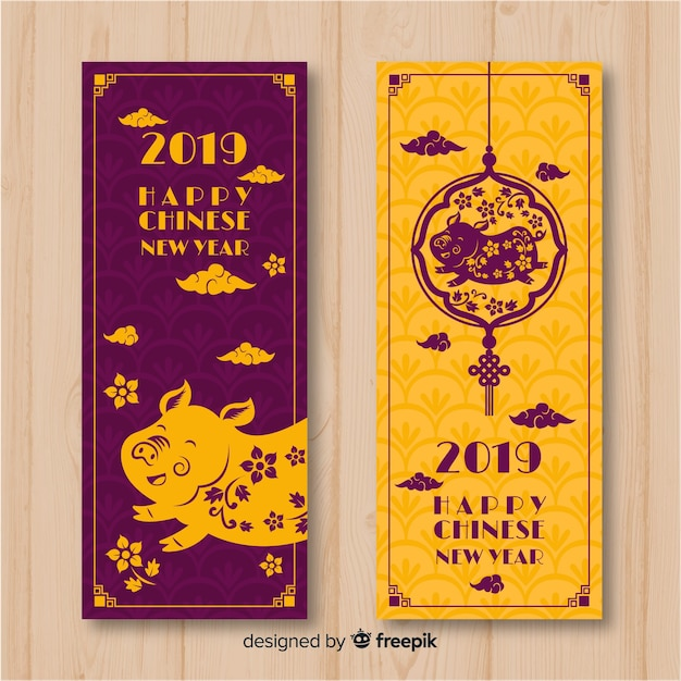 Floral pig chinese new year banner Free Vector