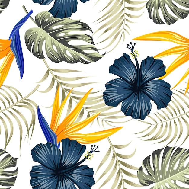 葉と花のシームレスなパターン。熱帯の背景 Premiumベクター
