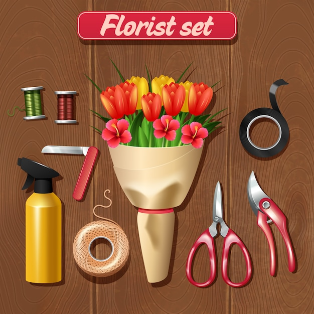 Florist accessories set with realistic bunch of flowers on wooden background Free Vector