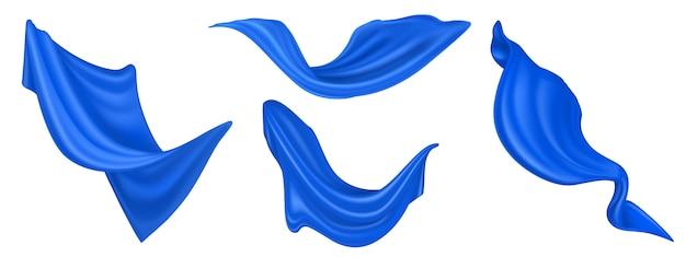 흰색 배경에 고립 된 비행 블루 실크 직물입니다. 부는 바람에 격렬 하 게 벨벳 옷, 스카프 또는 커튼의 벡터 현실적인 세트 무료 벡터