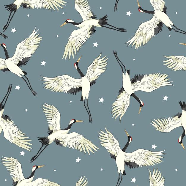 Flying crane seamless pattern Premium Vector