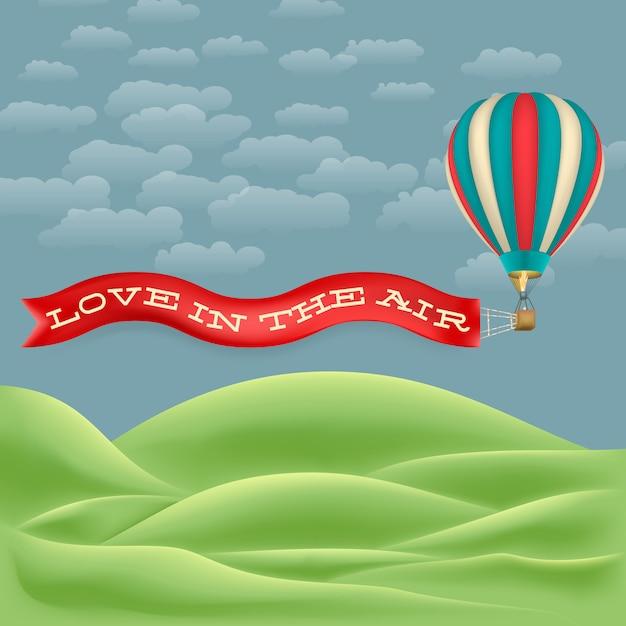 愛のリボンで空に熱気球を飛ばす Premiumベクター